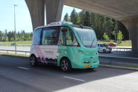 Robot bus in Helsinki, on a road under a bridge
